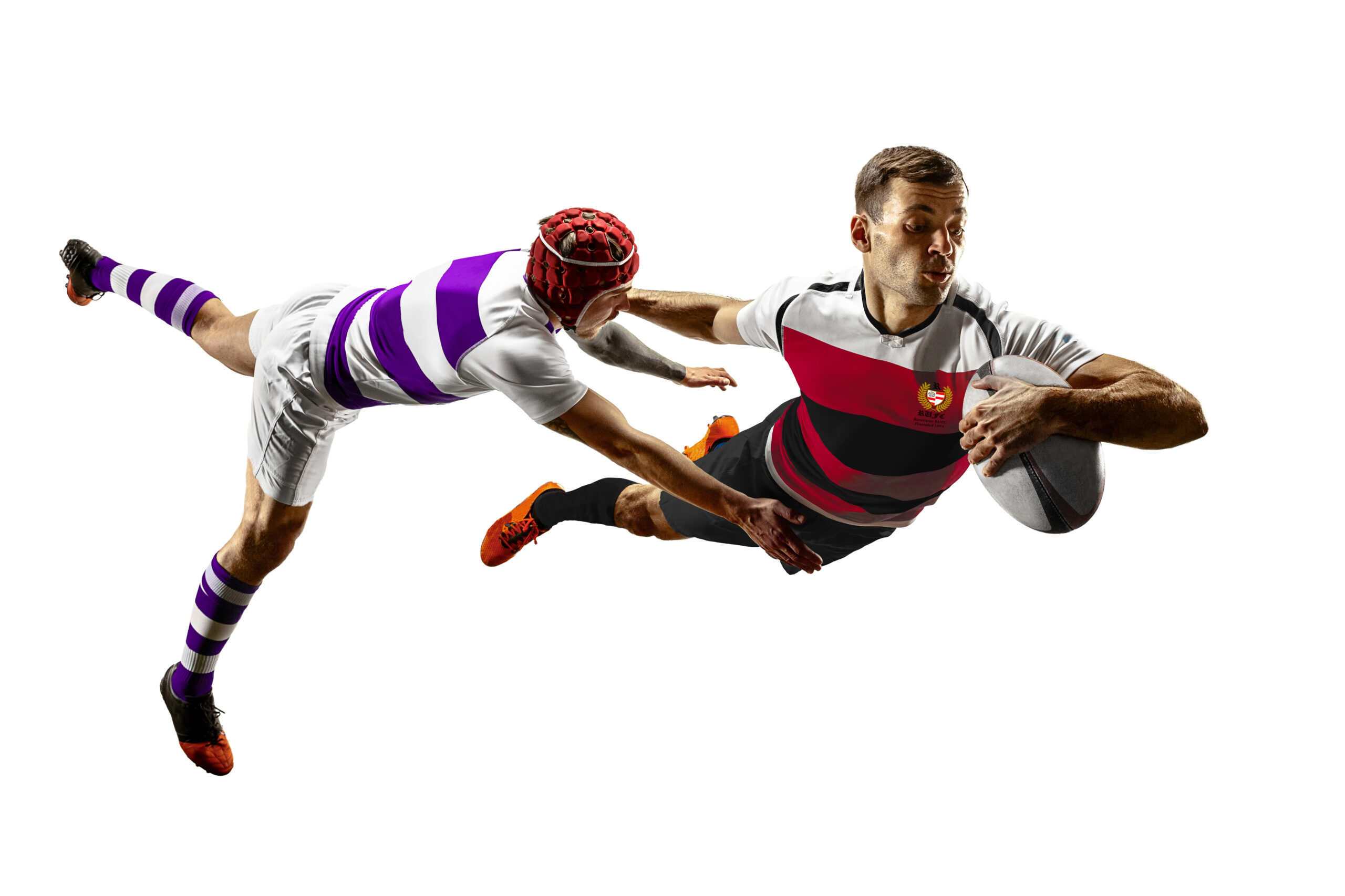 The silhouette of two caucasian rugby male players isolated on white background. Studio shot of fit men in motion or movement with ball. Jump and action concept. An incredible strain of all forces.